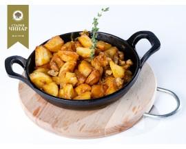 Fresh potatoes with pork salo and onion